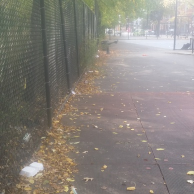 litter around perimeter of playground