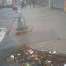 another autumn catch basin clogged with leaves and trash
