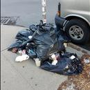 Garbage bags next to lamp post