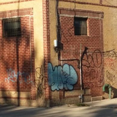 Graffiti all over building.
